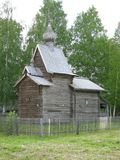Wooden church chapel ancient buildings. From gray boards with a dome on a background of greenery historical building in the Russian province Stock Images