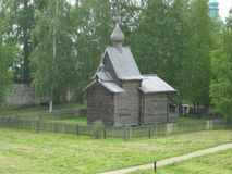 Wooden church chapel ancient buildings. From gray boards with a dome on a background of greenery historical building in the Russian province Royalty Free Stock Image