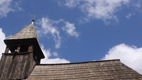 Wooden church and clouds stock footage