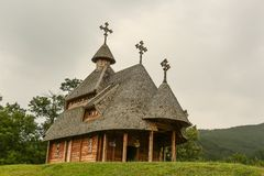 Wooden church on a cloudy day Stock Images
