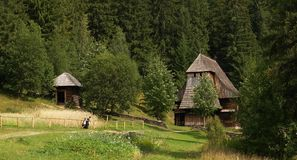 Wooden church in countryside. Old wooden church in countryside with forest in background, Orava open-air museum village, Slovakia Stock Photo