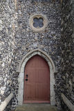 Wooden church door. A wooden church door with a small round window on top Royalty Free Stock Photo