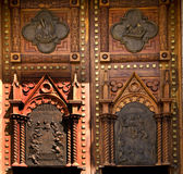 Wooden Church Doors Mexico. Wooden Church Doors with Metal Religious and Mexican Symbols and Decorations, Temple Expiatorio, Temple of Atonement, Guadalajara Stock Image
