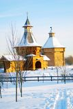 Wooden church and fortress tower in Kolomenskoye park in winter. Royalty Free Stock Image