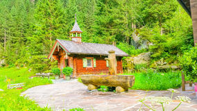 Wooden church and green pines, Austria, Alps Stock Image