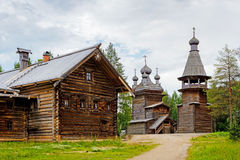 Wooden church and house Royalty Free Stock Photo
