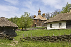 Wooden church and houses, Ukraine Royalty Free Stock Image