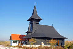 Wooden church on large field stock photography
