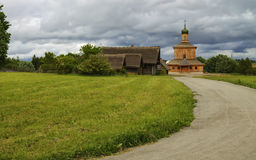 Wooden Church lawn road sky Royalty Free Stock Photography