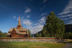 Wooden church in Lom, Norway. Wooden church with wall in Lom, Norway Royalty Free Stock Images