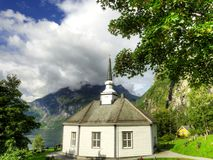 Wooden Church in Norway. This is an example of a wooden church. Geiranger Church is octagonal and was built in 1842 in timber, seating 120. it overlooks Royalty Free Stock Image