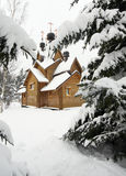 Wooden Church On A Snowy Meadow Royalty Free Stock Photo