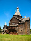 Wooden church. Wooden orthodox church on a background of blue sky stock photos