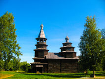 Wooden church. Wooden orthodox church on a background of blue sky stock image