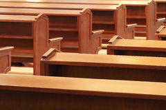 Wooden church pews in church stock image