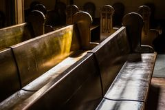 Wooden Church Pews. Rows of Typical Wooden Church Pews with Sunlight falling upon them Stock Photography
