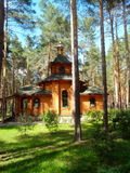 A wooden church in pine forest royalty free stock photos