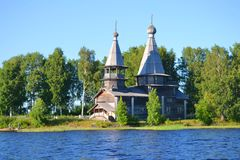 Wooden Church on the shore of the lake Royalty Free Stock Images