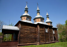 Wooden church with three domes Stock Photo