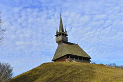Wooden church on top of hill and blue sky. Royalty Free Stock Image