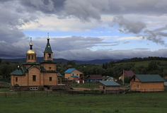 Wooden church in the village Starobelokuriha Royalty Free Stock Photography