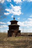 A wooden church was built in a field Royalty Free Stock Images