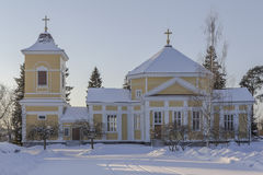 Wooden church. A wooden church in the winter in western Finland stock images