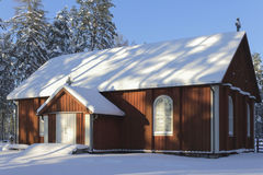 Wooden church. In wintry countryside in Finland royalty free stock images