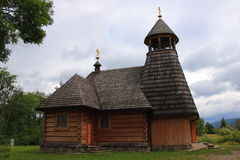 The wooden church in Wola Michowa (Bieszczady, Poland). The wooden church dedicated to Our Lady of Czestochowa Wola Michowa (Bieszczady Poland). The construction Royalty Free Stock Image