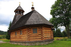 The wooden church in Wola Michowa (Bieszczady, Poland). The wooden church dedicated to Our Lady of Czestochowa Wola Michowa Bieszczady Poland. The construction Stock Photo