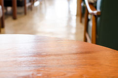 Wooden circle table top and blur cafe background Royalty Free Stock Photography