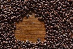 Wooden circular space in bunch of roasted coffee beans Stock Photography