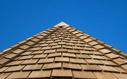 Wooden Cladded Roof. A wonderful blue sky behind a cladded wooden roof stock images