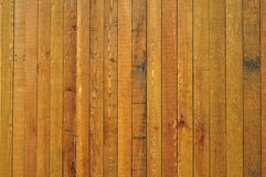 Wooden cladding panels. A close up of dark wooden cladding panels on side of a building Royalty Free Stock Image