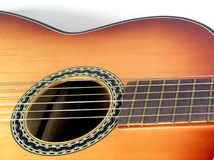 Wooden classical guitar. Zoom on a beautiful string instrument Royalty Free Stock Photography