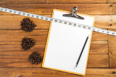 Wooden Clipboard attach planning paper with pencil beside coffee Royalty Free Stock Image
