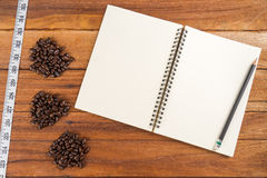 Wooden Clipboard attach planning paper with pencil beside coffee Royalty Free Stock Photo