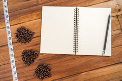 Wooden Clipboard attach planning paper with pencil beside coffee Stock Photography