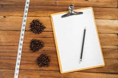 Wooden Clipboard attach planning paper with pencil beside coffee Stock Images