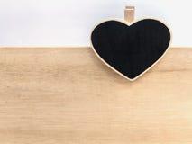 Wooden clipboard heart shape on wood board Stock Photo