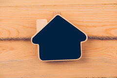 Wooden clipboard house ahape Royalty Free Stock Photography