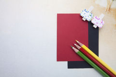 Wooden clips, sticky notes and color pencils Royalty Free Stock Photos
