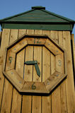 Wooden Clock. On Playground royalty free stock photography