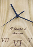 Wooden clock. With text under the lancet Stock Photography