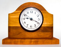 Wooden Clock. With multi colored layers of wood. Created by a craftsman. On white background royalty free stock photos