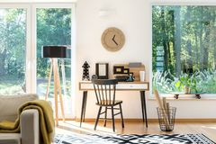 Free Wooden Clock Above Desk Royalty Free Stock Image - 107812856