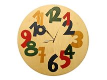 Wooden clock with color numbers isolated Royalty Free Stock Photos