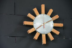 Wooden clock on the wall Royalty Free Stock Photos