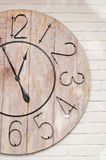Wooden clockface on white wall royalty free stock image