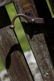 Wooden closed gate in the countryside.Old wooden gate lock close-up. Royalty Free Stock Photography